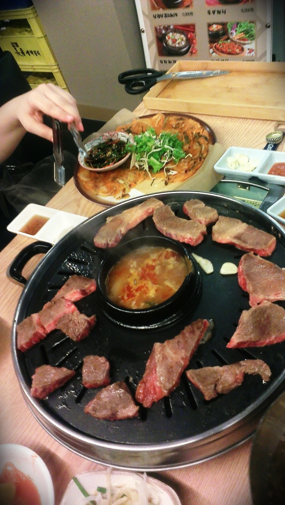 Korean barbecue - meat is cut with scissors