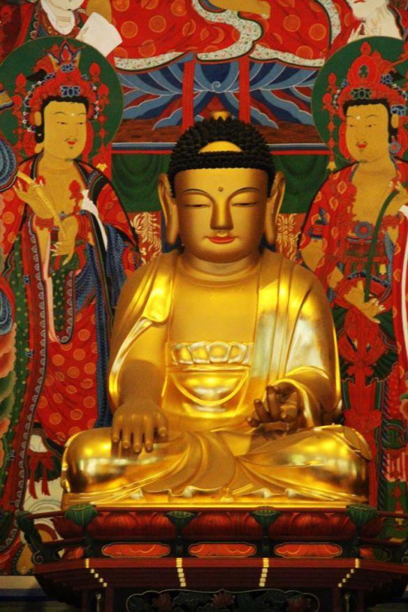 The Buddha looks like is wearing a baseball cap!